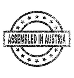 Grunge textured assembled in austria stamp seal vector