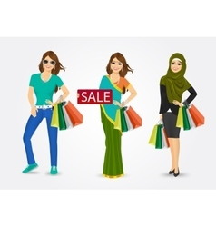 Women holding shopping bags vector
