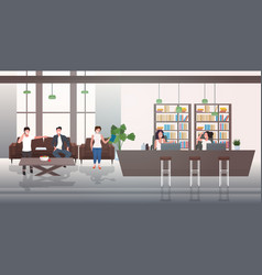 Businesspeople discussing during meeting in lobby vector
