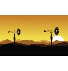 At sunset windmill scenery of silhouettes vector image