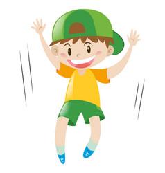 Little boy in yellow shirt jumping vector