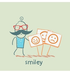 a man stands next to posters with smiles vector image