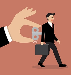 Hand turns on businessman with wind up key in his vector image