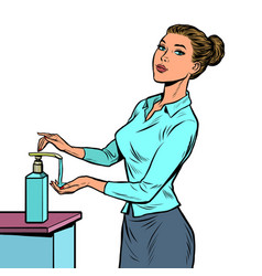 A woman uses hand sanitizer vector