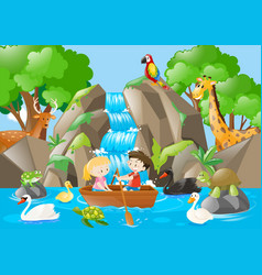Kids rowing boat in the river full of animals vector