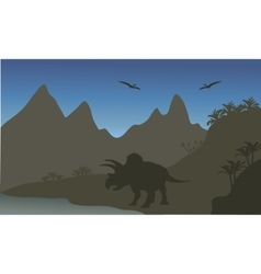 Silhouette of pterodactyl and triceratops vector