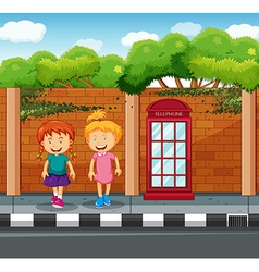 Two girls standing at the pavement vector