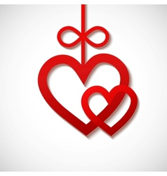 two heart sliced from red paper vector image
