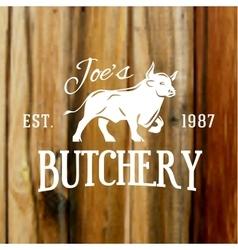 Premium vintage beef bull label on blurred wood vector image
