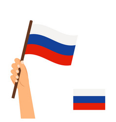 human hand holding flag russia vector image