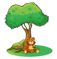 A bear sitting under a big tree vector image
