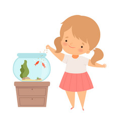 Little girl standing near fish bowl and feeding vector