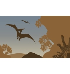 Silhouette of pterodactyl flying in forest vector