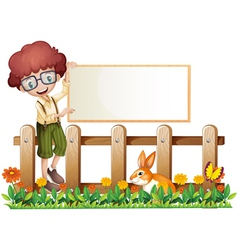 A boy at the fence holding an empty board vector image