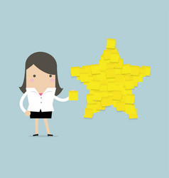 Businesswoman with star shape yellow sticky notes vector