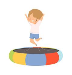 Happy boy bouncing on a trampoline kid vector