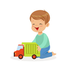 cute happy little boy sitting on the floor playing vector image