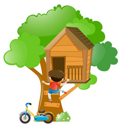 Boy climbing up the treehouse vector