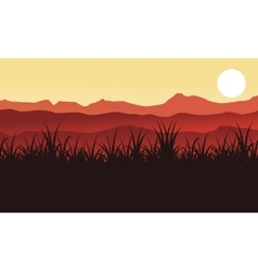 Silhouette of farm and grass scenery vector