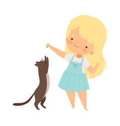 Little girl playing with her cat pet holding vector