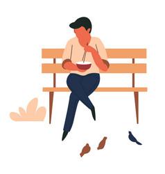 man eating noodles on park bench street food vector image