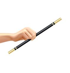 Realistic magic wand in hand vector