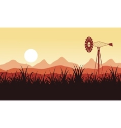 Silhouette of windmill on the farm scenery vector image