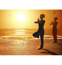 Silhouettes of Girls Doing Yoga on the Beach vector image