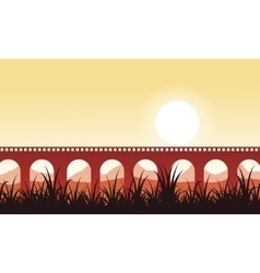 Long bridge at sunrise scenery silhouettes vector image