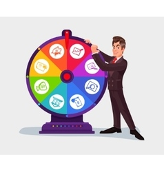 Business man spinning the wheel of fortune vector image