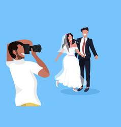 wedding photographer shooting on camera newlyweds vector image