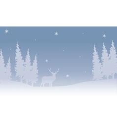 Silhouette of Christmas deer in snow vector
