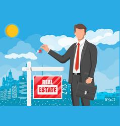 Businessman or realtor holding key vector