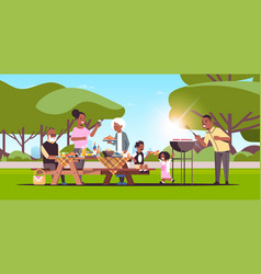 multi generation family preparing hot dogs on vector image