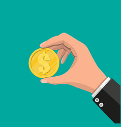 Gold coin in hand vector