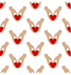 heart in hands seamless pattern vector image