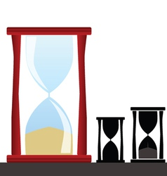 Hourglass with black silhouette vector