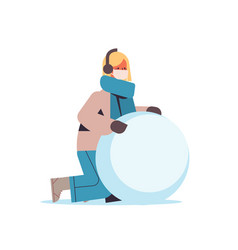 woman in mask making big snowball for snowman girl vector image