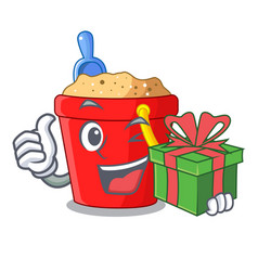 With gift picture beach bucket on shovel cartoon vector
