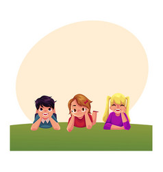 Three happy children lying on green grass under vector
