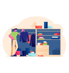 Young handsome man stand at home wardrobe looking vector