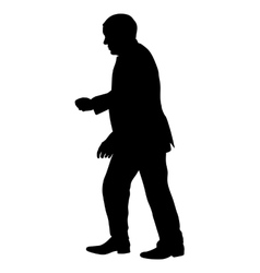 Silhouette of a man with his hand raised vector image vector image