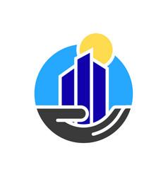 city building in hand logo vector image