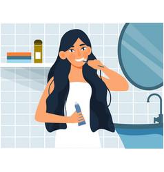 Woman brushing teeth vector