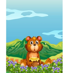 A bear at the flower plantation vector image vector image