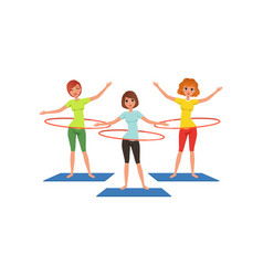 Sporty young girls doing hula-hoop workout vector