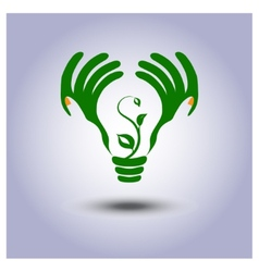 Green ecology light bulb icon in hands vector image