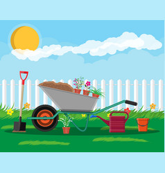 formal garden with wheelbarrow flowers shovel vector image