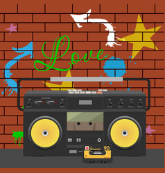 Tape stereo recorder over graffiti wall vector