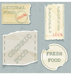 Labels of natural food on scraps of the old paper vector